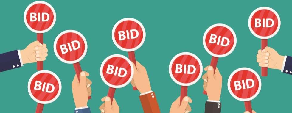 Hands holding bid signs - view WOW auctions now!